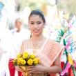 Stock Photo: CHIANG MAI, THAILAND - FEBRUARY 4: Traditionally dressed girl in