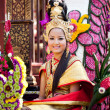 Stock Photo: CHIANG MAI, THAILAND - FEBRUARY 4: Traditionally dressed smiling