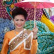 CHIANG MAI, THAILAND - FEBRUARY 4: Traditionally dressed woman o - Stock Photo