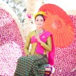 Stock Photo: CHIANG MAI, THAILAND - FEBRUARY 4: Traditionally dressed womi