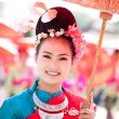 CHIANG MAI, THAILAND - FEBRUARY 4: Traditionally dressed woman p - Stock Photo