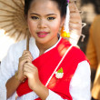 CHIANG MAI, THAILAND - FEBRUARY 4: Traditionally dressed smiling - Stock Photo