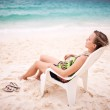 Woman in a chair — Stock Photo