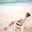 Pensive woman on the beach — Stock Photo