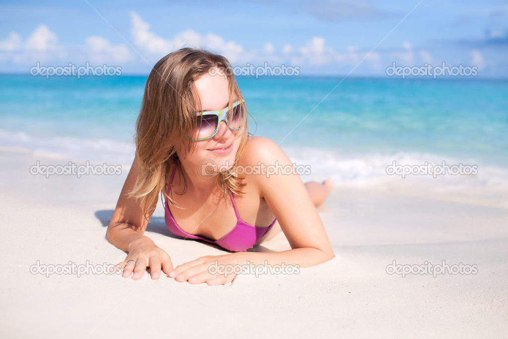 Happy Woman Resting on a Beach — Stock Photo #9292158