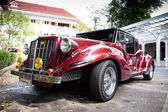HUA HIN - DECEMBER 19: Red Car on Vintage Car Parade 2009 at Sof — Stock Photo