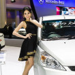 Stock Photo: Female presenter at booth Proton