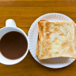 Coffee cup and Pour the milk toast — Stock Photo