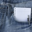 Blue jeans  and notepad — Stock Photo