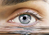 Human eye reflected — Stock Photo