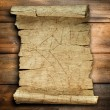 Vintage old paper scroll at wood — 图库照片
