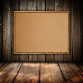 Cork board at wooden wall background — Stock Photo