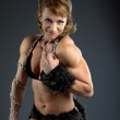 Strong woman body builder smile with chain — Stock Photo