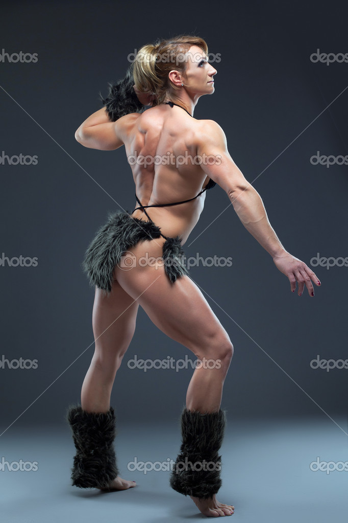 Heavy body builder woman in amazon fur costume  Stock Photo #10143382