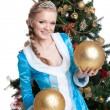 Sexy christmas girl smile and hold gold balls — Stock Photo