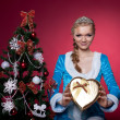 Christmas girl in blue sexy cloth with present — Stock Photo