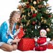 Beauty christmas girl play with baby santa claus — Stock Photo