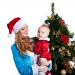 Christmas girl with baby santa claus portrait — Stock Photo