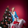 Snow Maiden and baby santa claus portrait — Stock Photo #8062280