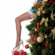 Christmas girl show sexy leg from new year tree — Stock Photo