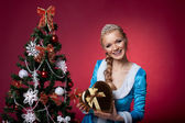 Christmas girl in blue sexy cloth with gift box — Stock Photo
