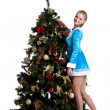 Stock Photo: Young christmas girl decorate new year fir tree