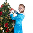 Young christmas girl decorate new year fir tree — Stock Photo