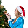 Young christmas girl decorate new year fir tree — ストック写真