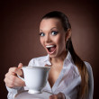 Funny Woman with cup of coffee smile at brown — Stock Photo