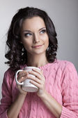 Woman in rose jacket with cup of tea — Stock Photo