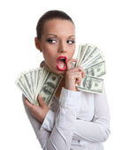 Young sexy woman with bundle of money wipe a mouth — Stock Photo