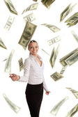 Happy business woman in flying lots of money — Stock Photo