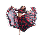 Beauty girl jump in gypsy dance isolated — Stock Photo