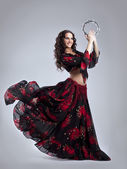 Young woman dance in gypsy with tambourine — Stock Photo