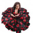 Young woman posing in flamenco costume isolated — Stock Photo