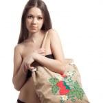 Girl in black bikini with funny beach bag — Stock Photo #9135606