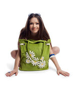 Yong woman sit with green beach bag smile isolated — Stock Photo