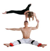Two young acrobats show stand on hand — Stock Photo