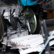Ready newspaper on production line in a print shop — Stock Photo