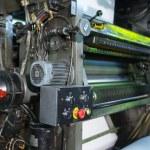 Print shop machine detail yellow color close-up — Stock Photo