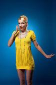 Amazing woman in yellow dress surpized — Stock Photo