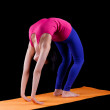 Woman exercise bridge yoga asana  on orange mat - Stock fotografie