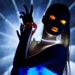 Disco girl with glow make-up dance in uv light — Stock Photo