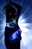 Girl with ultraviolet make-up disco dance — Stock Photo