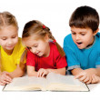 Stock Photo: Small kids with a book
