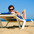 Beautiful girl lying on a lounger — Stock Photo