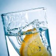 Slice of lemon in a glass of water — Stock Photo #10047665