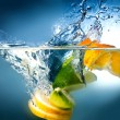 Stock Photo: Citrus fall into water