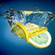 Stock Photo: Lemon into water