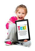 Little girl with a Tablet PC — Stock Photo